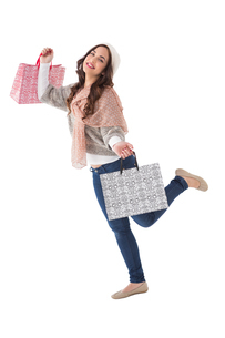 Pretty brunette posing with shopping bagsの写真素材 [FYI00004559]