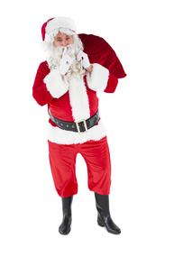 Santa holding sack and keeping a secretの写真素材 [FYI00004571]