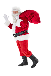 Santa holding a sack and wavingの写真素材 [FYI00004575]