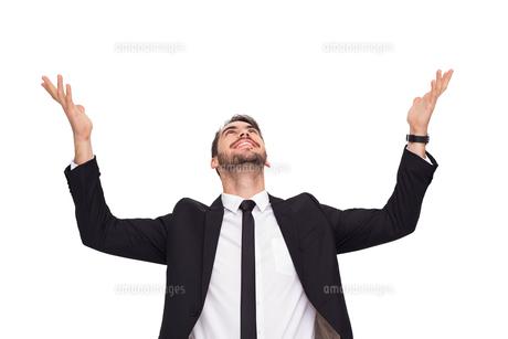 Businessman cheering with hands raisedの写真素材 [FYI00004584]