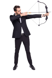 Businessman shooting a bow and arrowの写真素材 [FYI00004588]