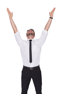 Smiling businessman cheering with his hands upの写真素材 [FYI00004592]