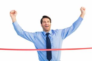 Happy businessman crossing finishing lineの写真素材 [FYI00004754]