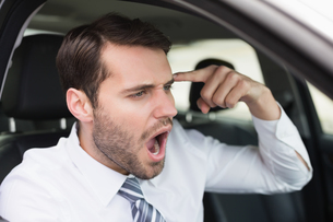Businessman experiencing road rageの写真素材 [FYI00005269]