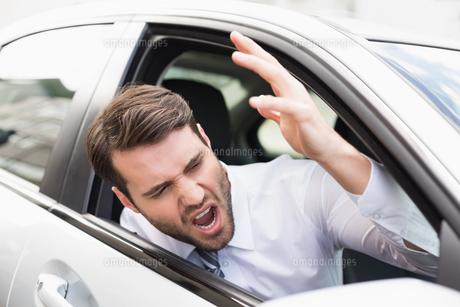 Businessman experiencing road rageの写真素材 [FYI00005278]