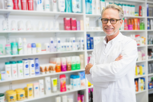 Handsome pharmacist smiling at cameraの写真素材 [FYI00005416]