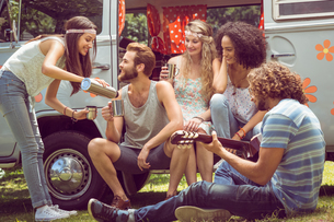Hipster friends in camper van at festivalの素材 [FYI00005598]