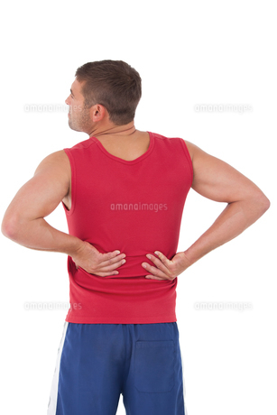Fit man with injured backの写真素材 [FYI00005661]