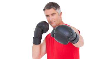 Fit man punching with boxing glovesの写真素材 [FYI00005680]