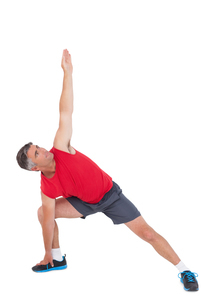 Fit man stretching his legs and armsの写真素材 [FYI00005687]