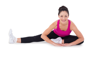 Fit woman stretching her legsの写真素材 [FYI00005690]