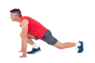 Fit man stretching his legsの写真素材 [FYI00005693]