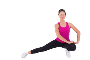 Fit woman stretching her legの写真素材 [FYI00005695]