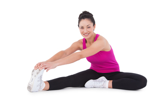 Fit woman stretching her legsの写真素材 [FYI00005696]