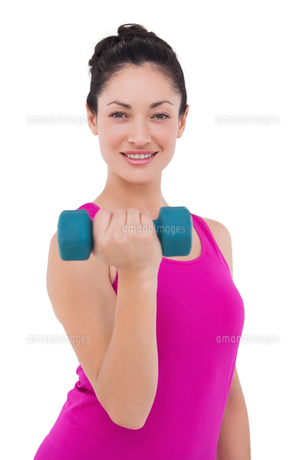 Fit woman lifting blue dumbbellの素材 [FYI00005697]