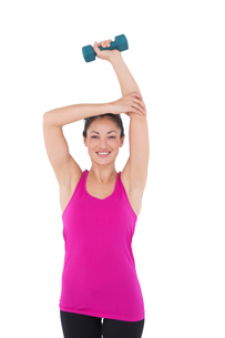 Fit woman with blue dumbbellの素材 [FYI00005698]