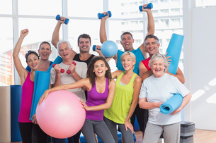 Excited people holding exercise equipmentの写真素材 [FYI00005791]