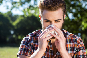 Handsome hipster blowing his noseの写真素材 [FYI00005827]