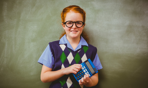 Portrait of cute little girl holding calculatorの写真素材 [FYI00006031]