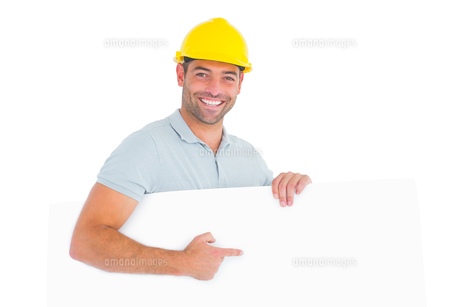 Foreman pointing at blank board on white backgroundの素材 [FYI00006136]