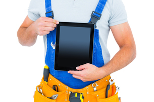 Midsection of repairman holding digital tabletの写真素材 [FYI00006144]