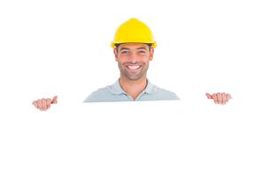 Happy handyman holding placard on white backgroundの素材 [FYI00006145]