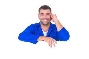 Handsome mechanic with blank placardの素材 [FYI00006154]