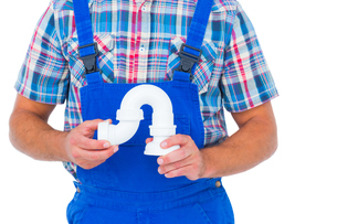 Plumber holding sink pipe on white backgroundの写真素材 [FYI00006159]