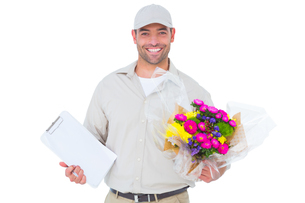 Happy flower delivery man holding clipboardの写真素材 [FYI00006172]