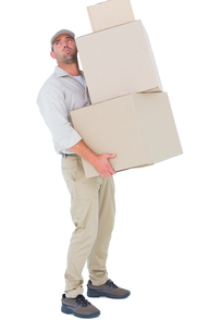 Tired delivery man carrying stack boxesの写真素材 [FYI00006173]