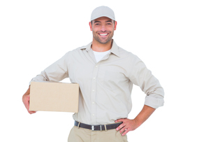 Confident delivery man with cardboard box on white backgroundの写真素材 [FYI00006174]