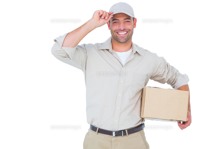 Portrait of happy delivery man with cardboard box wearing capの素材 [FYI00006176]
