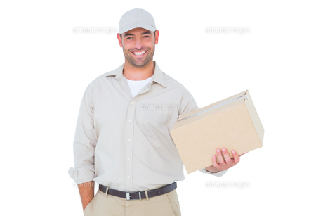 Handsome delivery man with cardboard box on white backgroundの写真素材 [FYI00006177]