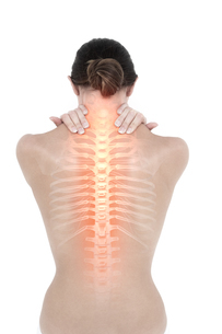 Highlighted back pain of womanの写真素材 [FYI00006261]