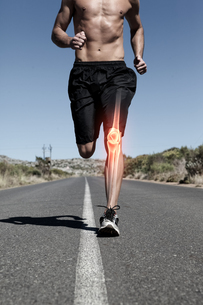 Highlighted knee bone of running manの写真素材 [FYI00006265]