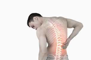 Highlighted spine of man with back painの素材 [FYI00006282]