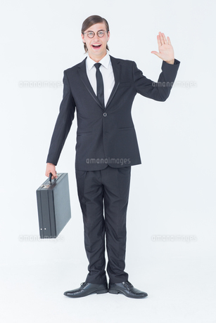 Geeky businessman waving at cameraの素材 [FYI00006382]