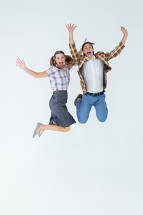 Geeky hipsters jumping and smilingの写真素材 [FYI00006383]