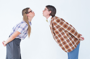 Geeky hipster couple kissingの写真素材 [FYI00006385]