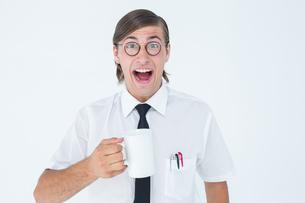 Geeky businessman holding a mugの写真素材 [FYI00006392]