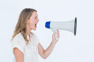 Woman shouting through a loudspeakerの写真素材 [FYI00006429]