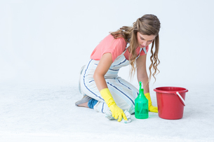 Hipster woman cleaning the groundの写真素材 [FYI00006451]