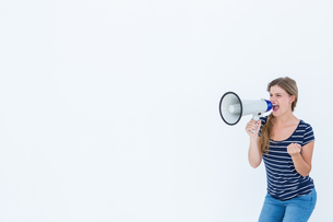 Woman shouting through a loudspeakerの写真素材 [FYI00006473]