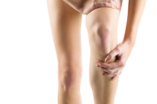 Woman with knee injuryの写真素材 [FYI00006679]
