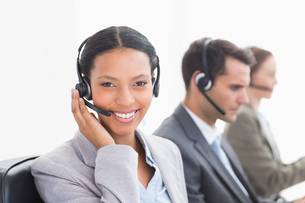 Business people with headsets using computersの写真素材 [FYI00007464]