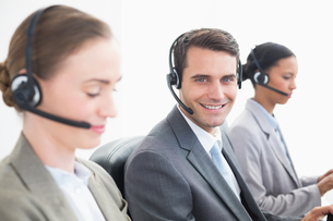 Business people with headsets using computersの写真素材 [FYI00007468]