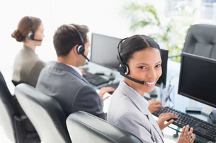 Business people with headsets using computersの写真素材 [FYI00007473]