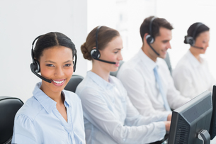 Business people with headsets using computersの写真素材 [FYI00007481]
