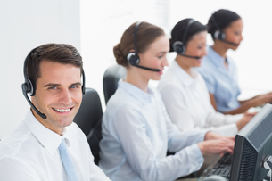 Business people with headsets using computersの写真素材 [FYI00007484]