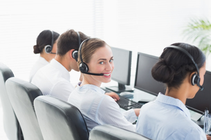 Business people with headsets using computersの写真素材 [FYI00007486]